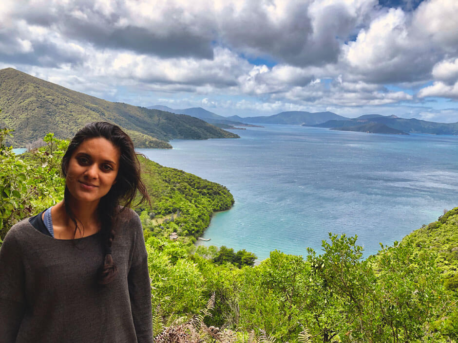 Portrait of Zarina with the Queen Charlotte Sound in the background along the Queen Charlotte Track